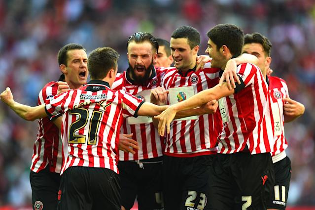 LONDON, ENGLAND - APRIL 13: Stefan Scougall of Sheffield United is mobbled by his team mates after scoring their second goal during the FA Cup with Budweiser semi-final match between Hull City and Sheffield United at Wembley Stadium on April 13, 2014 in London, England. (Photo by Shaun Botterill/Getty Images)