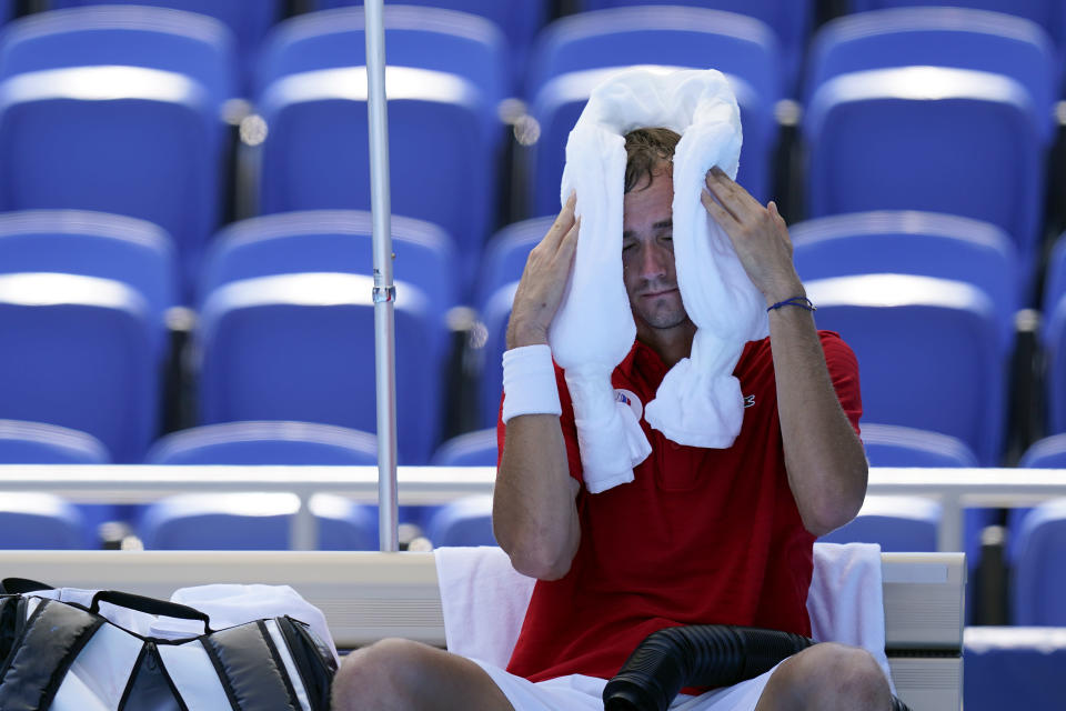 Daniil Medvedev, of the Russian Olympic Committee, cools off during a changeover in a tennis match against Alexander Bublik, of Kazakhstan, during at the 2020 Summer Olympics, Saturday, July 24, 2021, in Tokyo, Japan. (AP Photo/Patrick Semansky)
