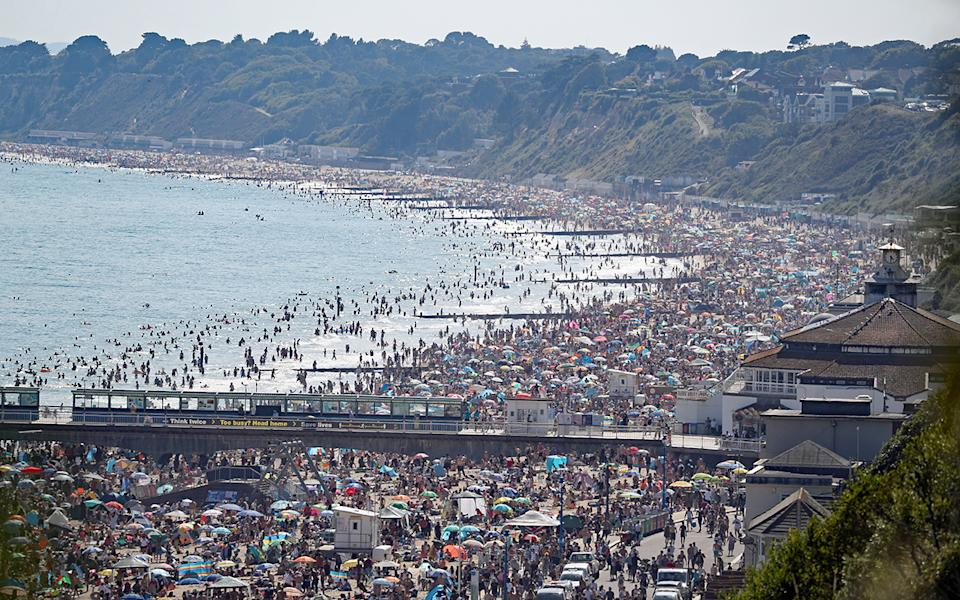 The scene on the beach in Bournemouth, Dorset, after the UK officially recorded its warmest day of the year so far when the temperature reached 32.6C (90.7F) at London's Heathrow Airport at 2.46pm.. Picture date: Wednesday June 24, 2020. See PA story WEATHER Hot. Photo credit should read: Andrew Matthews/PA Wire