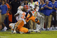 Florida wide receiver Jacob Copeland, center, fumbles as he is hit by Tennessee linebacker Jeremy Banks (33) and defensive back Alontae Taylor (2) during the first half of an NCAA college football game, Saturday, Sept. 25, 2021, in Gainesville, Fla. Tennessee recovered the ball. (AP Photo/John Raoux)