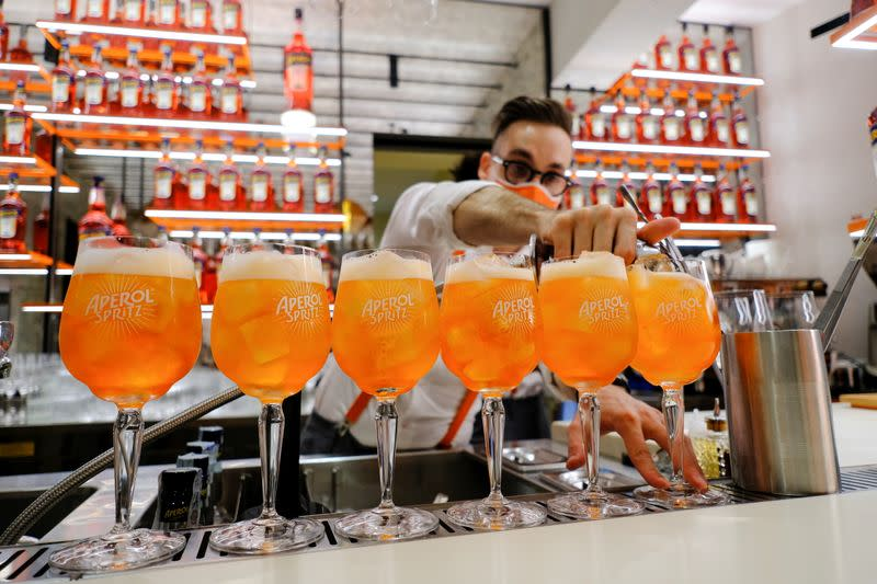 A bartender pours a drink at a Campari inauguration of a new brand house for Aperol, its best-selling beverage, in Venice, Italy
