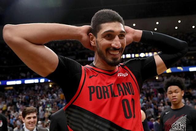 "<a class=""link rapid-noclick-resp"" href=""/nba/players/4899/"" data-ylk=""slk:Enes Kanter"">Enes Kanter</a> provided a T-shirt for a camp player with a <a class=""link rapid-noclick-resp"" href=""/nba/players/4612/"" data-ylk=""slk:Stephen Curry"">Stephen Curry</a> jersey. (Photo by Matthew Stockman/Getty Images)"