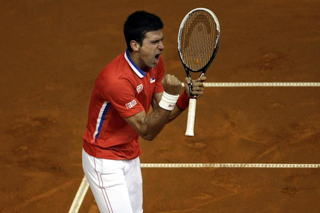 Serbia's Novak Djokovic celebrates after having won a point against Canada's Milos Raonic during their Davis Cup semifinals tennis match in Belgrade, Serbia, Sunday, Sept. 15, 2013. (AP Photo/ Marko Drobnjakovic)