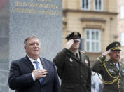 U.S. Secretary of State Mike Pompeo, left, attends a ceremony at the General Patton memorial in Pilsen near Prague, Czech Republic, Tuesday, Aug. 11, 2020. U.S. Secretary of State Mike Pompeo is in Czech Republic at the start of a four-nation tour of Europe. Slovenia, Austria and Poland are the other stations of the trip. (AP Photo/Petr David Josek, Pool)