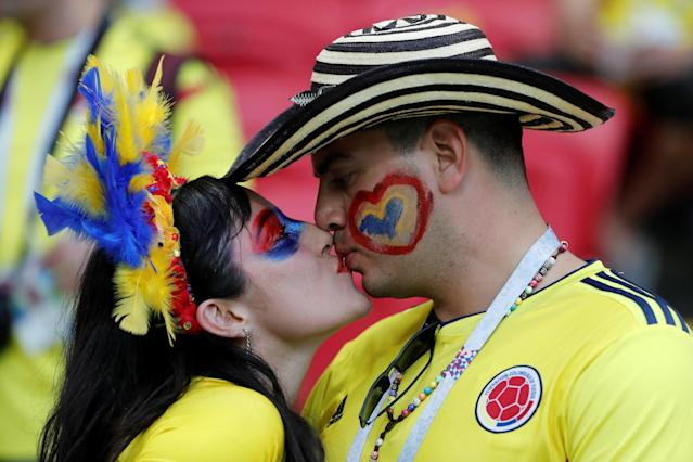 Soccer Football - World Cup - Group H - Poland vs Colombia - Kazan Arena, Kazan, Russia - June 24, 2018 Colombia fans kiss in the stadium before the match REUTERS/Toru Hanai