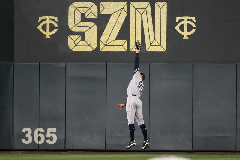 New York Yankees right fielder Aaron Judge catches a fly ball hit by Minnesota Twins' Miguel Sano during the sixth inning in Game 3 of a baseball American League Division Series, Monday, Oct. 7, 2019, in Minneapolis. (AP Photo/Bruce Kluckhohn)