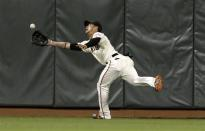 San Francisco Giants center fielder Gregor Blanco catches a fly ball hit by Houston Astros' Jordan Schafer during the seventh inning of a baseball game in San Francisco, Wednesday, June 13, 2012. (AP Photo/Jeff Chiu)
