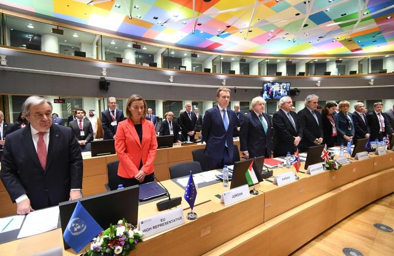 UN Secretary General Antonio Guterres (L) and EU foreign policy chief Federica Mogherini (2nd L) and international representatives are seen while attending an EU-Syria conference on supporting the future of the region in Brussels April 5, 2017