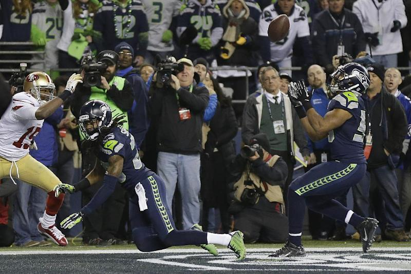 Malcolm Smith's interception off a pass Richard Sherman deflected is one of the greatest moments in NFC championship game history. (AP)