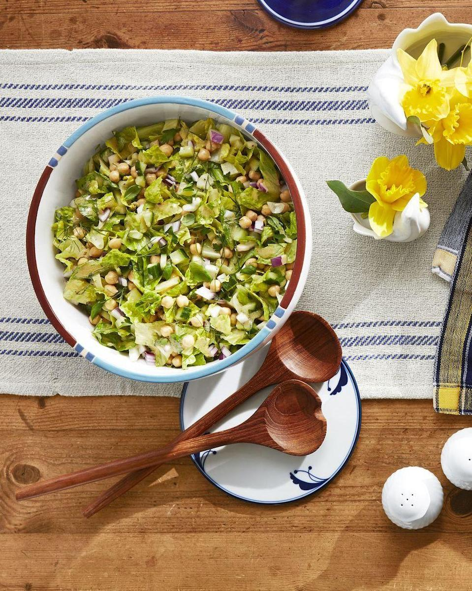 "<p>This crunchy chopped salad gets a dash of flavor from the dijon mustard, as well as a good amount of protein from the chickpeas. </p><p><strong><em>Get the recipe at <a href=""https://www.countryliving.com/food-drinks/a27498240/chopped-salad-recipe/"" rel=""nofollow noopener"" target=""_blank"" data-ylk=""slk:Country Living"" class=""link rapid-noclick-resp"">Country Living</a>.</em></strong></p><p><strong><a class=""link rapid-noclick-resp"" href=""https://www.pamperedchef.com/shop/Entertaining/Serveware/Wood+Salad+Bowl/100188"" rel=""nofollow noopener"" target=""_blank"" data-ylk=""slk:SHOP SALAD BOWLS"">SHOP SALAD BOWLS</a></strong></p>"