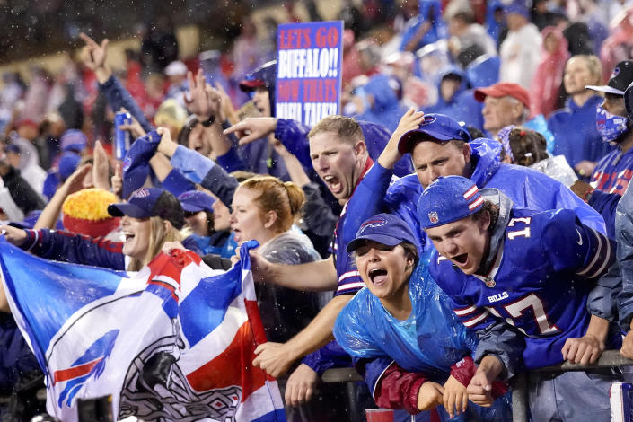 Buffalo Bills fans celebrate late in an NFL football game against the Kansas City Chiefs Sunday, Oct. 10, 2021, in Kansas City, Mo. The Bills won 38-20. (AP Photo/Charlie Riedel)