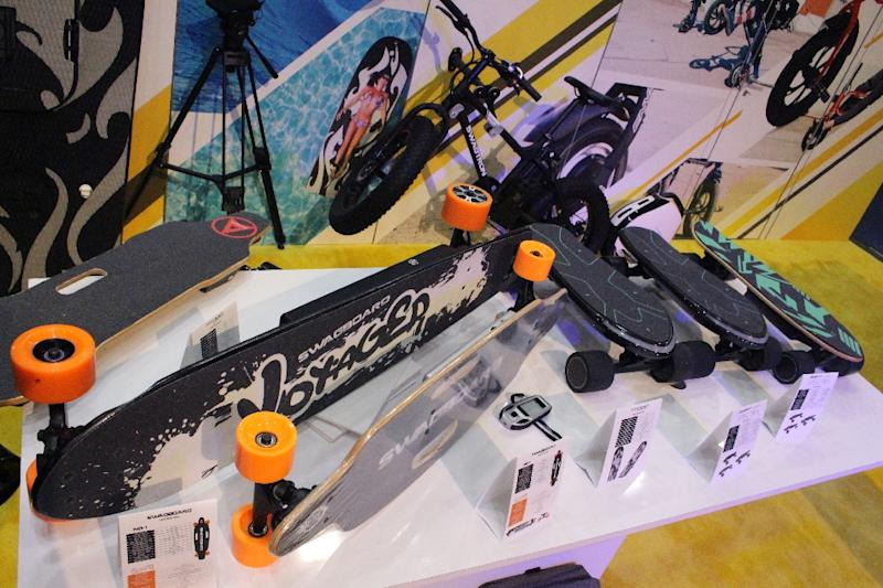 Swagtron skateboards powered by electric motors are among the alternatives to cars displayed at the 2018 Consumer Electronics Show (AFP Photo/Glenn CHAPMAN)