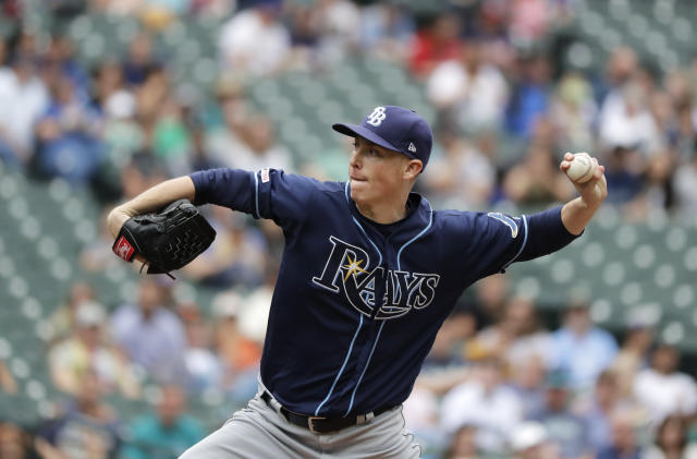 Tampa Bay Rays starting pitcher Ryan Yarbrough throws against the Seattle Mariners during the first inning of a baseball game, Sunday, Aug. 11, 2019, in Seattle. (AP Photo/Ted S. Warren)