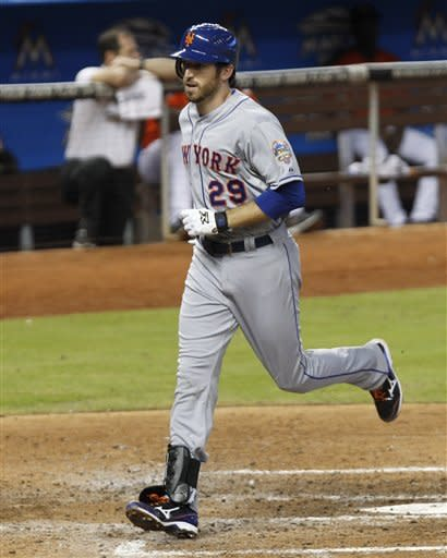 New York Mets' Ike Davis crosses home plate after hitting a solo home run against the Miami Marlins in the sixth inning of a baseball game in Miami, Wednesday, Oct. 3, 2012. The Mets won 4-2. (AP Photo/Alan Diaz)