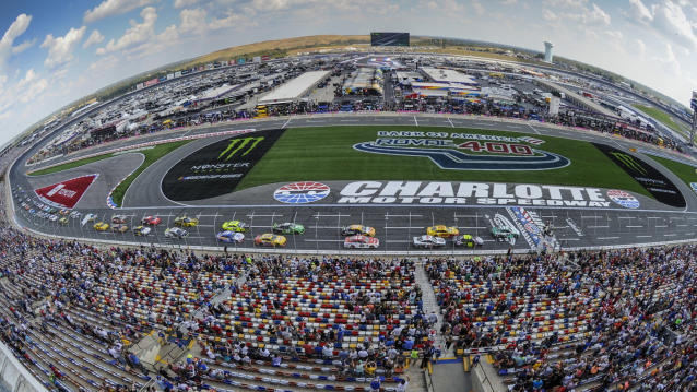William Byron (24) leads the field to the start of a NASCAR Cup Series auto race at Charlotte Motor Speedway Sunday, Sept. 29, 2019 in Concord, N.C. (AP Photo/Mike McCarn)