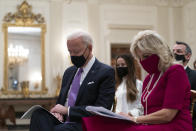 President Joe Biden bows his head in prayer, during a virtual Presidential Inaugural Prayer Service, accompanied by first lady Jill Biden, second from right, in the State Dinning Room of the White House, Thursday, Jan. 21, 2021, in Washington. (AP Photo/Alex Brandon)