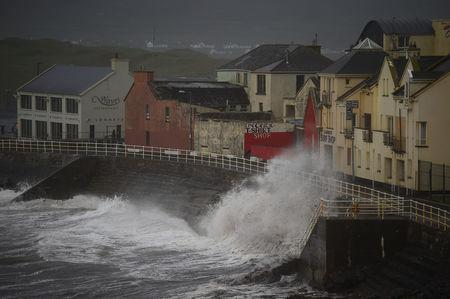 Winds batter the coast as storm Ophelia hits the County Clare town of Lahinch. REUTERS/Clodagh Kilcoyne
