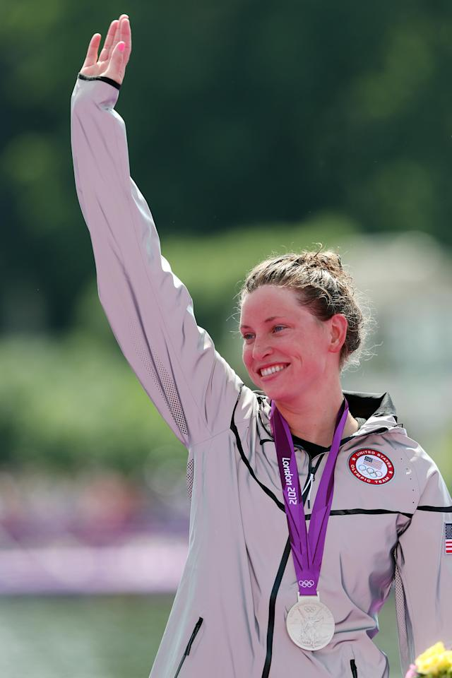 LONDON, ENGLAND - AUGUST 09: Silver medalist Haley Anderson of the United States celebrates on the podium during the medal ceremony for the Women's Marathon 10km Swimming at Hyde Park on August 9, 2012 in London, England. (Photo by Clive Rose/Getty Images)
