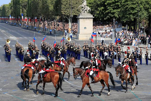 <p>Members of the Republican Guard ride horses during the traditional Bastille Day military parade on the Champs-Élysées in Paris, France, July 14, 2018. (Photo: Gonzalo Fuentes/Reuters) </p>