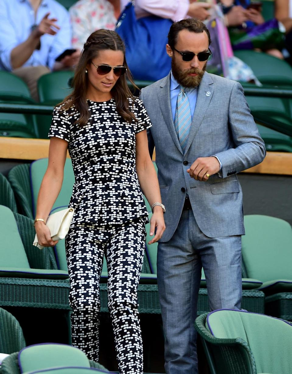 <p>Pippa turned to Carolina Herrera for one of her Wimbledon 2015 looks. The brunette donned a monochrome jumpsuit with a peplum top for the occasion. <i>[Photo: PA Images]</i> </p>
