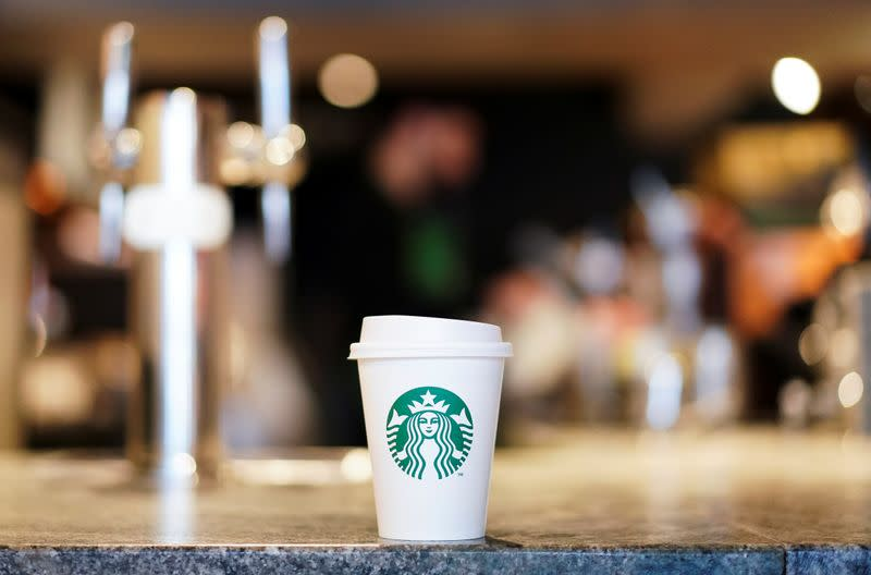 A single use coffee cup inside a Starbucks in London