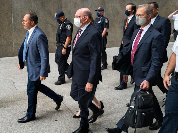The Trump Organization's Chief Financial Officer Allen Weisselberg, center, leaves after a courtroom appearance in New York, Monday, Sept. 20, 2021 (AP)