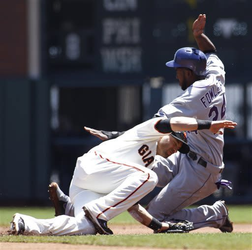 Colorado Rockies' Dexter Fowler steals second base as San Francisco Giants' Marco Scutaro covers during the first inning of the MLB National League baseball game, Sunday, May 26, 2013 in San Francisco. (AP Photo/George Nikitin)