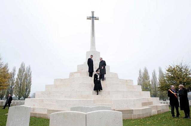 <p>Britain's Princess Anne, front center, walks down the steps of the Cross of Sacrifice at Tyne Cot cemetery in Zonnebeke, Belgium on Saturday, Nov. 11, 2017. Tyne Cot Cemetery is the resting place of 11,954 soldiers of the Commonwealth Forces from the First World War. (Photo: Virginia Mayo/AP) </p>