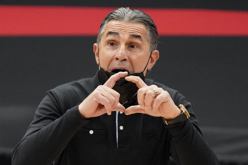 Toronto Raptors assistant coach Sergio Scariolo calls a play during the first half of an NBA basketball game against the Houston Rockets Friday, Feb. 26, 2021, in Tampa, Fla. Scariolo is filling in for head coach Nick Nurse, who is missing the game due to coronavirus protocol. (AP Photo/Chris O'Meara)