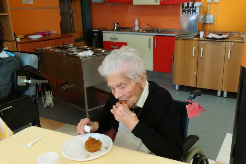 """In this photo taken on April 6, 2020, 103-year-old Ada Zanussi, eats her meal at the nursing home """"Maria Grazia"""" in Lessona, northern Italy, after recovering from Covid-19 infection. To recover from coronavirus infection, as she did, Zanusso recommends courage and faith, the same qualities that have served her well in her nearly 104 years on Earth. The new coronavirus causes mild or moderate symptoms for most people, but for some, especially older adults and people with existing health problems, it can cause more severe illness or death. (Residenza Maria Grazia Lessona via AP Photo)"""