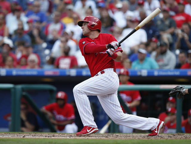 Philadelphia Phillies' Rhys Hoskins hits a two-run single against the Miami Marlins during the third inning of a baseball game Thursday, Aug. 24, 2017, in Philadelphia, Pa. (AP Photo/Rich Schultz)