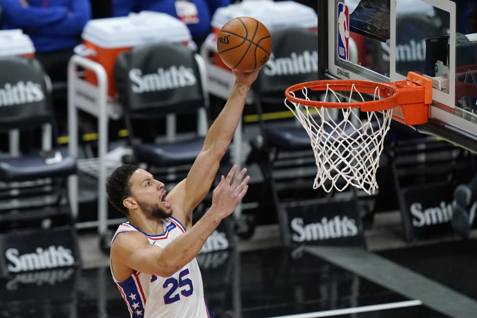 Philadelphia 76ers guard Ben Simmons (25) lays the ball up in the first half during an NBA basketball game against the Utah Jazz Monday, Feb. 15, 2021, in Salt Lake City. (AP Photo/Rick Bowmer)