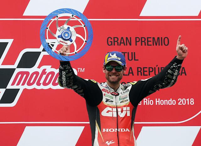 Motorcycle Racing - Argentina Motorcycle Grand Prix - MotoGP race - Termas de Rio Hondo, Argentina - April 8, 2018 - LCR Honda Castrol rider Cal Crutchlow of Britain celebrates on the podium. REUTERS/Marcos Brindicci