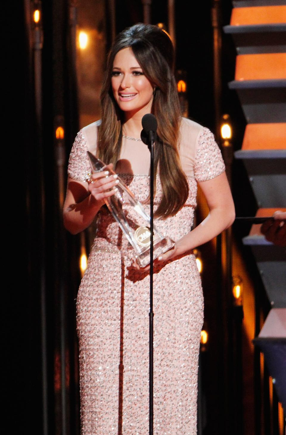 Kacey Musgraves accepts the award for Song of the Year during the 48th annual CMA awards at the Bridgestone Arena on Nov. 5, 2014 in Nashville. (Photo: Terry Wyatt/FilmMagic)
