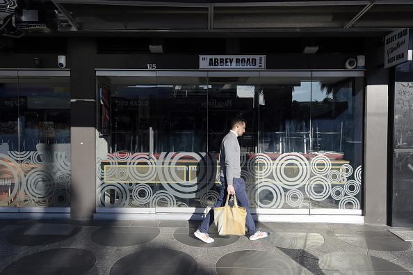 A pedestrian walks past a closed cafe during a lockdown in the St Kilda suburb of Melbourne, Australia.