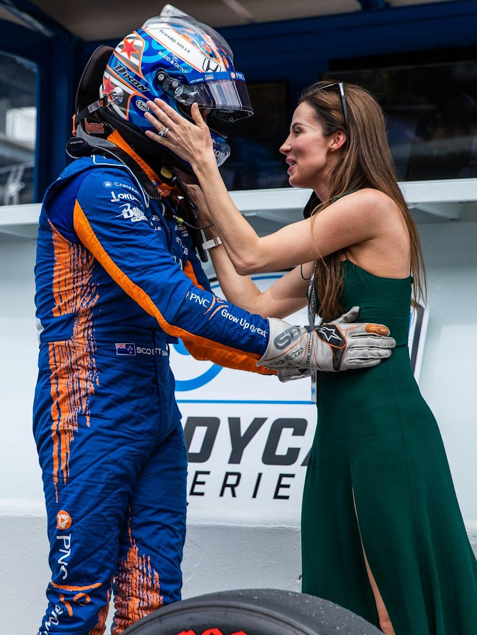 Chip Ganassi Racing driver Scott Dixon (9) gets out of his car to wife Emma Davies-Dixon Saturday, May 22, 2021, after landing the pole position during Fast Nine qualifying for the 105th running of the Indianapolis 500 at Indianapolis Motor Speedway.