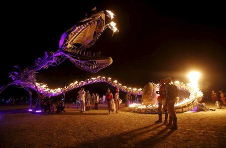 """People gather at the art installation Serpent Mother during the Burning Man 2015 """"Carnival of Mirrors"""" arts and music festival in the Black Rock Desert of Nevada, September 1, 2015.  REUTERS/Jim Urquhart"""