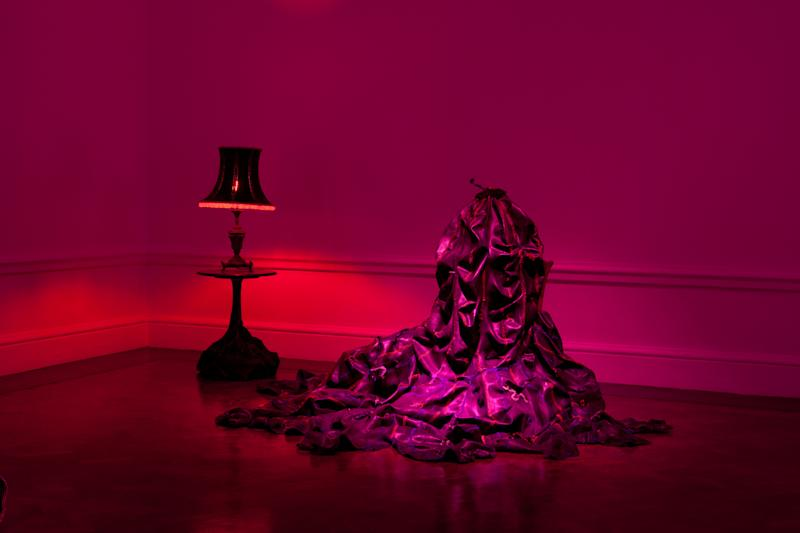 "This undated image released by Nicholas Hlobo and Stevenson shows the art piece ""Kubomvu (2009),"" made from a found table, found lamp, rubber inner tube, ribbon and red light bulb. The work will appear as part of South African artist Nicholas Hlobo's new installation ""Intethe (Sketch for an Opera)"" at Locust Projects in Miami during Art Basel Miami Beach, Dec. 5-8. (AP Photo/Nicholas Hlobo and Stevenson)"