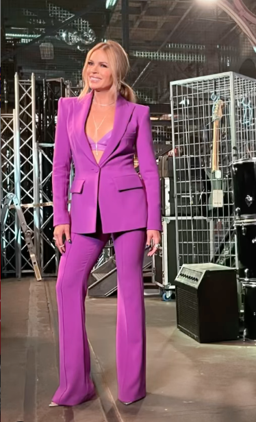 Sonia Kruger in a purple suit