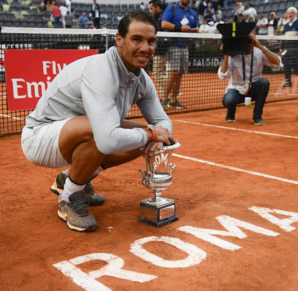 Comeback king: Rafael Nadal poses with the trophy (AFP Photo/Filippo MONTEFORTE)