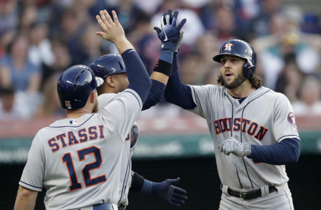 Houston Astros' Jake Marisnick, right, is congratulated by Yuli Gurriel and Max Stassi after all three scored on a three-run home run during the sixth inning of a baseball game against the Cleveland Indians, Thursday, May 24, 2018, in Cleveland. (AP Photo/Tony Dejak)