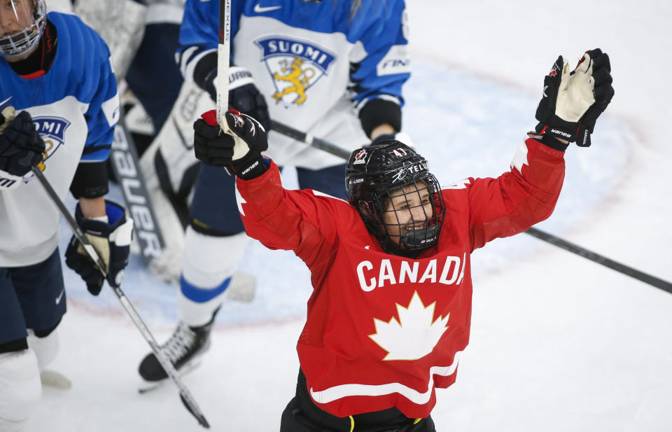 Canada's Jamie Rattray celebrates her goal against Finland during the second period of an IIHF women's hockey championships game in Calgary, Alberta, Friday, Aug. 20, 2021. (Jeff McIntosh/The Canadian Press via AP)