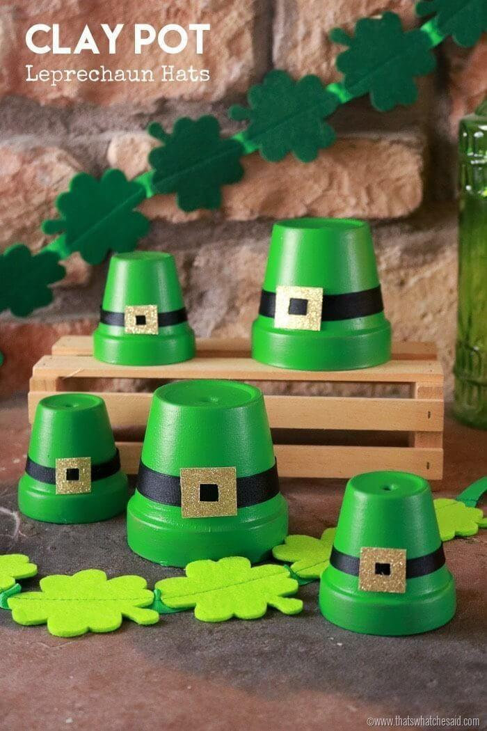 """<p>Transform empty clay pots into leprechaun hats that you can use to decorate your mantle, dining room table or kid's nightstand. </p><p><em><a href=""""https://www.thatswhatchesaid.net/clay-pot-leprechaun-hats/"""" rel=""""nofollow noopener"""" target=""""_blank"""" data-ylk=""""slk:Get the tutorial at That's What Che Said »"""" class=""""link rapid-noclick-resp"""">Get the tutorial at That's What Che Said »</a></em></p>"""