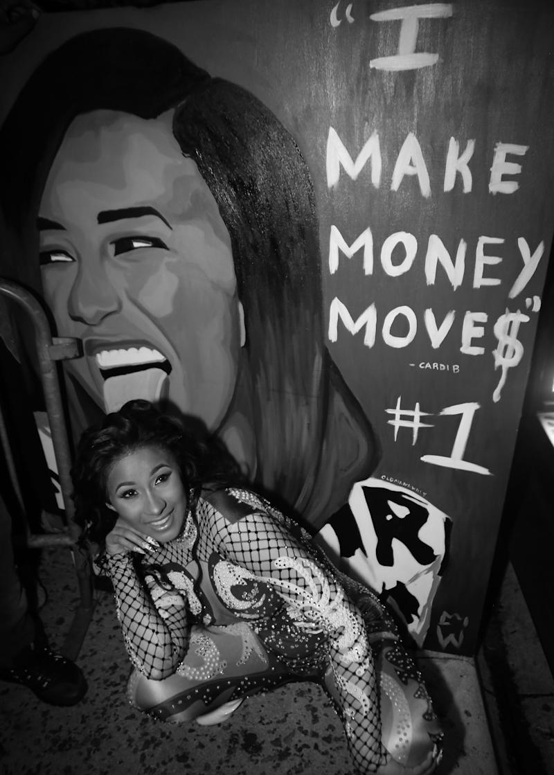 Cardi B poses with a fan made painting while leaving Revolution Live on Sept. 25, 2017 in Fort Lauderdale, Florida.  (Thaddaeus McAdams via Getty Images)