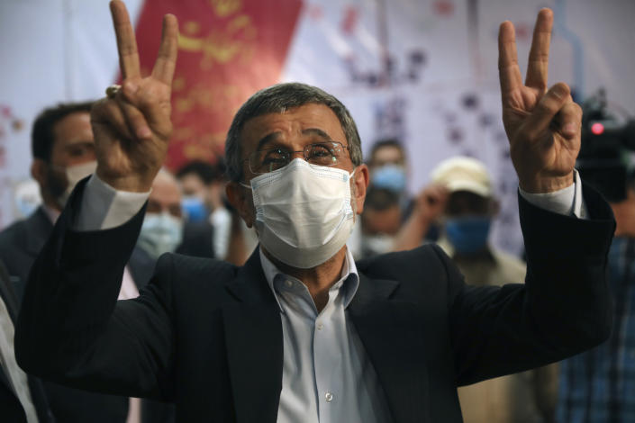 Former President Mahmoud Ahmadinejad flashes victory sign while registering his name as a candidate for the June 18, presidential elections at elections headquarters of the Interior Ministry in Tehran, Iran, Wednesday, May 12, 2021. The country's former firebrand president will run again for office in upcoming elections in June. The Holocaust-denying Ahmadinejad has previously been banned from running for the presidency by Supreme Leader Ayatollah Ali Khamenei in 2017, although then, he registered anyway. (AP Photo/Vahid Salemi)