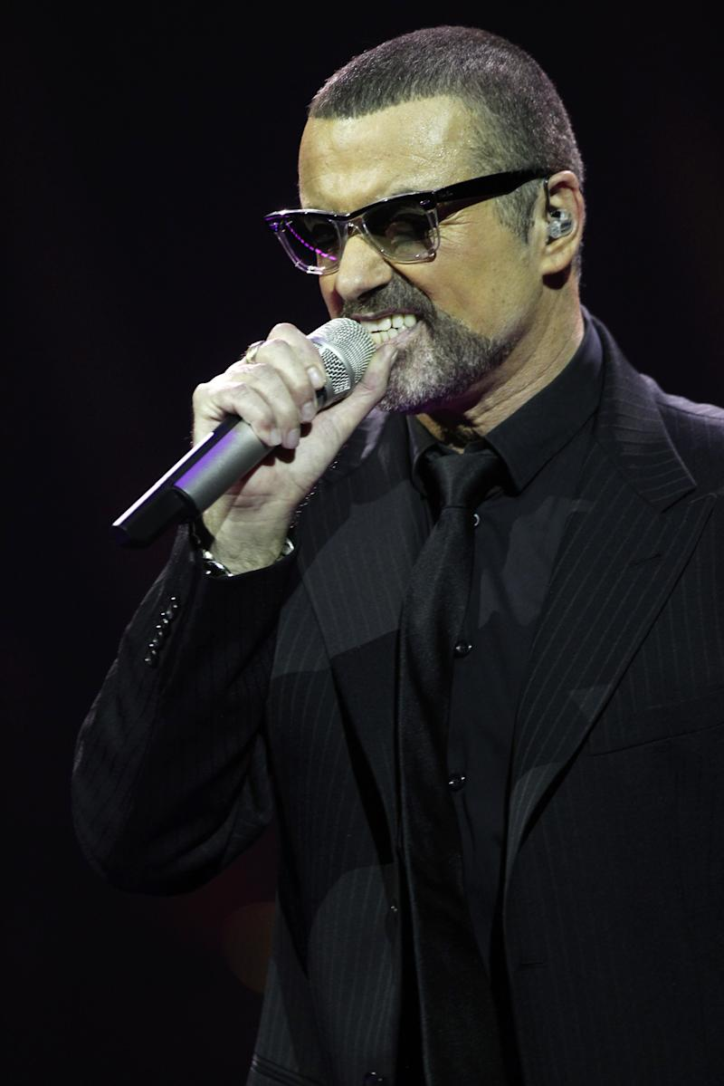 George Michael performs onstage for his Symphonica: The Orchestral Tour at The Royal Albert Hall on October 25, 2011 in London, United Kingdom. (Photo by Dave Hogan/Getty Images)