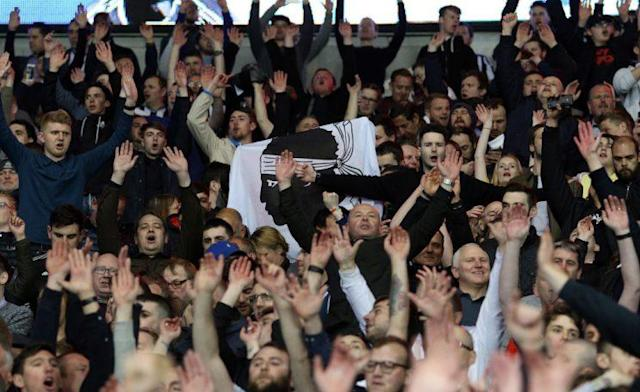 CARDIFF, WALES – APRIL 28: Newcastle United fans celebrate after the final whistle of the Sky Bet Championship match between Cardiff City and Newcastle United at the Cardiff City Stadium on April 28, 2017 in Cardiff, Wales. (Photo by Athena Pictures/Getty Images)