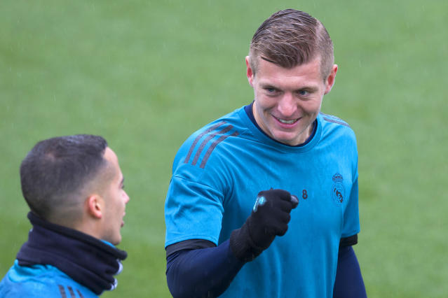 Real Madrid's Toni Kroos, right, shares a word with teammate Lucas Vazquez during a training session in Madrid (AP Photo/Paul White)