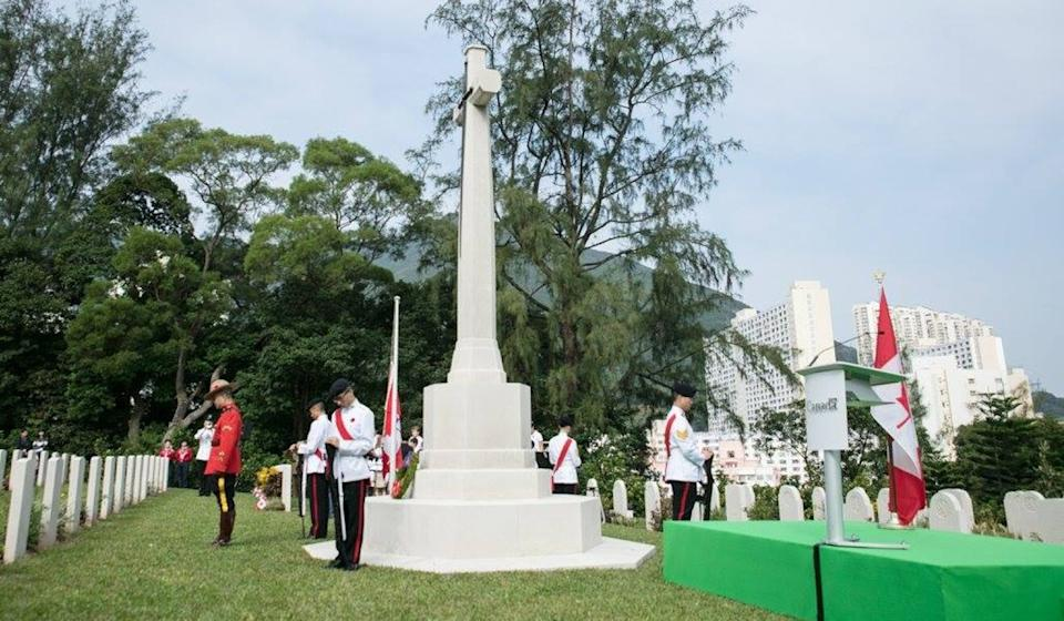 Ben Chang, left, in red, at the Canadian Commemorative Ceremony at the Sai Wan War Cemetery in December 2017. Photo: Global Affairs Canada