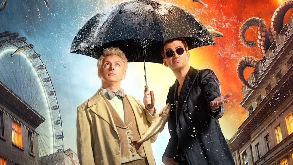 Michael Sheen and David Tennant under an umbrella on a Good Omens poster for the Good Omens audiobook article